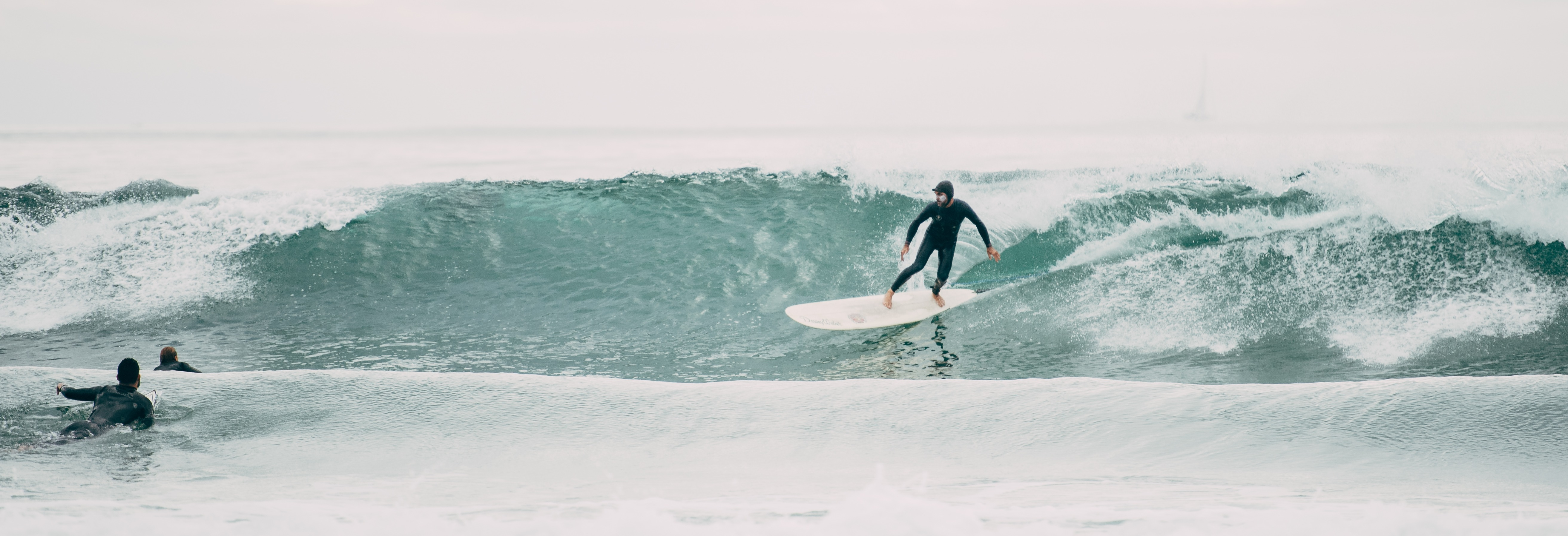 Canva - Person Riding Surfboard on Wave-cropped